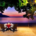 Romantic dinner by the beach.