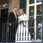 Mr. & Mrs. on front balcony of 109 West