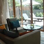 sitting area of the villa overlooking the charming garden and pool