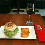 A Bernie's Burger and a glass of Cabernet Sauvignon 235,000 vnd, about $11.46 (FX rate may vary)