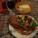 Pork chop, salad and red wine