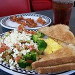 Hippy Hash breakfast with scrambled eggs, a side of bacon, and wheat toast!  Yummmmm!