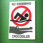 sign next to the crocodile tank