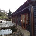 Back of lodge with veranda and pond