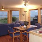 Chalets-cosy lounge with patio doors to look out on Scapa Flow and Hills of Hoy