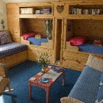 Living Room with cozy twin beds - board games and books in the shelf above