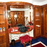 The paneled dressing room includes massive closet space and a dressing table.