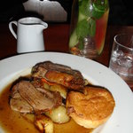 Garlic and mustard-crusted roast leg of lamb with yorkshire pudding