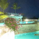 Nighttime shot of the adult pool and kids pool.  Notice the waterfalls not running.