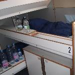 3 beds at the left side (and a lot of bottles of water)