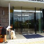Entrance Dog and staff at hotel