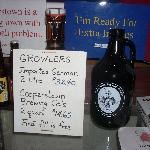 You can buy larger sizes of each beer called growlers.