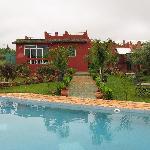 tuin, zwembad en gemeenscahppelike verblijfsruimte zoals eetgelegenheid, tv-kamer