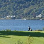 A lone golfer with Loch Lhinnie in the back ground