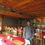 Dining room of Hotel Home with its owner/manager, Pema