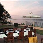 Outside dining offers spectacular views from Mukdahan Manor B & B and The Waterfront - Song Fung