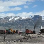 View of the railyard, mountains, and steam engine
