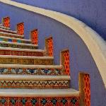 The sweeping spiral staircase leads you to the secure oceanside vacation rental Taj Mahajual