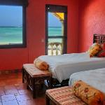 The 'Saluta de Fruta' or 'Tribute to Fruit' bedroom brings the festive colors of local tropical