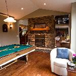 Pool table and library in loft