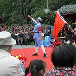 Performer in show at Peoples Park in Chengdu raising funds for landslide