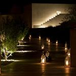 Path to villas lit by candles