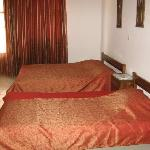 The first of the two bedrooms with a single and double bed