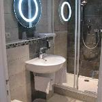Bathroom, toilet, and cool lighted mirror