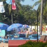 A view of simming pool nearby restaurant
