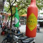 It has 2 Tabasco bottle hanging outside