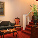 """Stairs from the  downstairs foyer of """"663"""" lead to the guest rooms, each with its  ensuite bathr"""