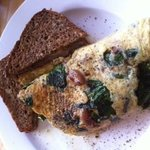 Roasted garlic, brie and spinach omelette with whole grain toast