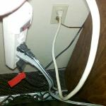 Creative solutions to no outlets.  Light, refrigerator, microwave, and TV in one outlet.