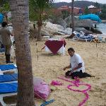 Staff Setting Up for Romantic Dinner on the Beach$$