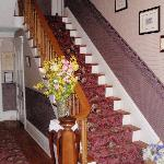 Stairs to second floor where rooms are located.