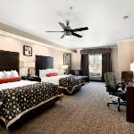 Each room offers a flat screen TV, microwave, mini-refrigerator, ceiling fan, sofa sleeper, and