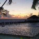 Sunrise over the yoga palapa at end of dock. Right outside front porch of room.