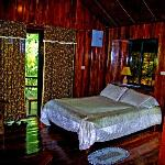 Single bed in one of the bungalows