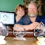 Carolyn & Steve celebrate latest awards