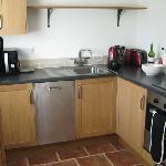 fully stocked kitchen with dishwasher