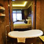 View of the room from the bathroom with open door