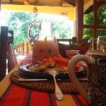 Breakfast: pancakes, guava syrup, papaya, fresh juice, coffeea