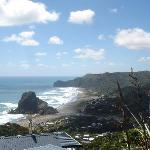 View of Piha Beach from turnout in winding road to get there