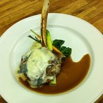 Milk fed veal chop topped with gorgonzola  cheese