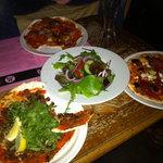 Lamb, veggie, and sausage pizzas at Bimbo's