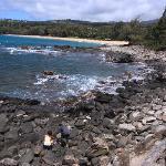 Climb down the rocks to the beach
