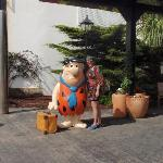 Fred Flintstone at the entrance to Welcome you