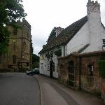 The Great stone inn between the village pound and medieval St. Lawrence Church.