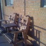 Porch chairs all around, complete with kitty basking in the sun