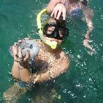 my friends with a sea cucumber and puffer fish that Rafa caught and released afterwards